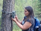 Celina Gray, a student intern at Salish Kootenai College, checks an automated camera.